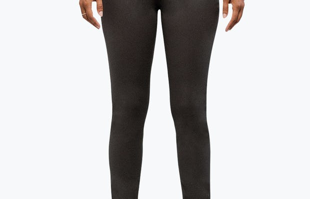Women's Charcoal Heather Kinetic Skinny Pant on Model with Arms by Her Side