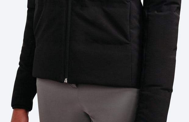 Women's Black Mercury Intelligent Heated Jacket on Model in Close-Up of Bottom Hemline