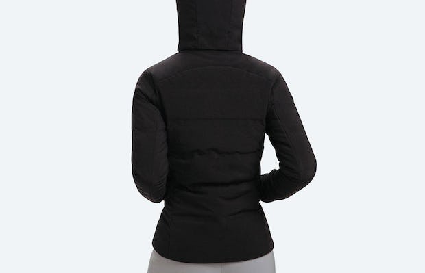 Women's Black Mercury Intelligent Heated Jacket on Model Facing Backward with Hood on Head