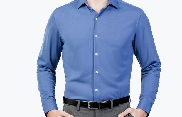 Men's Ocean Blue Apollo Dress Shirt on Model Facing Forward with Hands in Pants Pockets