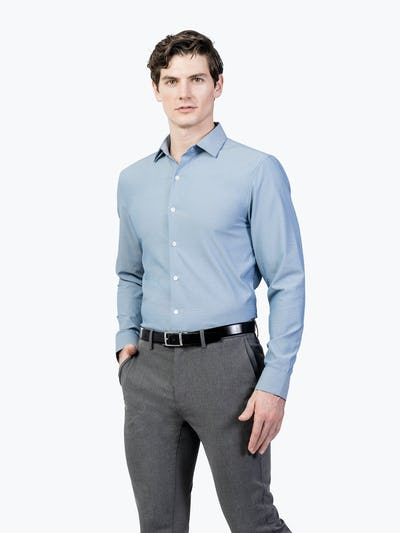 Men's Sky Blue Oxford Brushed Apollo Dress Shirt model facing forward and to the right with hand in pocket