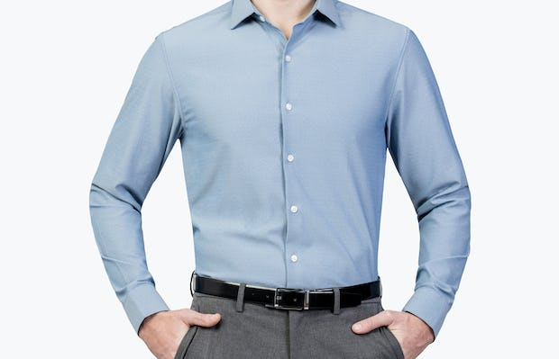 Men's Sky Blue Oxford Brushed Apollo Dress Shirt model facing forward and hands in pockets