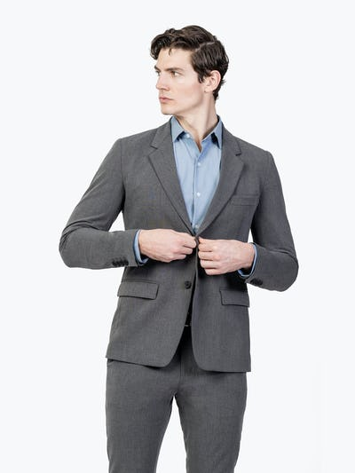 Men's Charcoal Velocity Suit Jacket on Model Adjusting Button