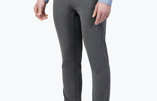 Men's Charcoal Velocity Dress Pants on Model Facing Left