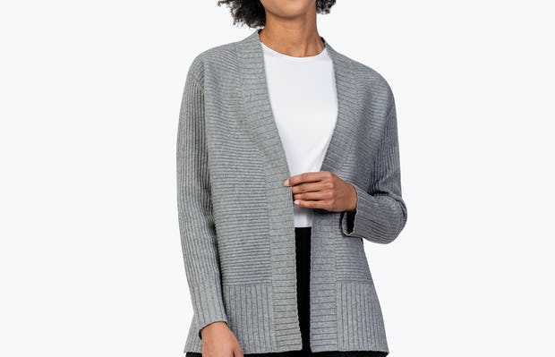 Women's Light Grey Composite Merino Cardigan on Model Touching Her Lapel
