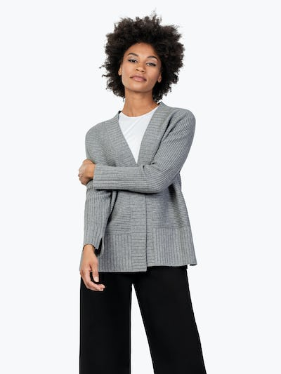 Women's Light Grey Composite Merino Cardigan on Model Holding Her Right Arm