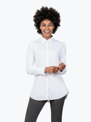Women's White Aero Tunic on Model Facing Forward and Smiling
