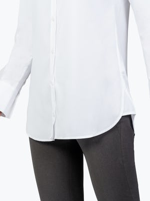 Women's White Aero Tunic on Model in Close-up of Her Shirt Tails