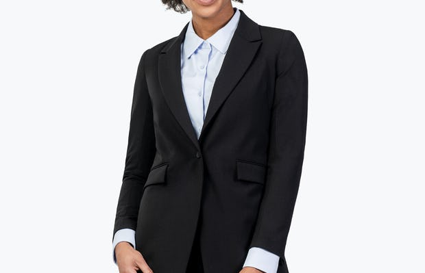 Women's Black Velocity Blazer on Model Leaning Forward and to the Right