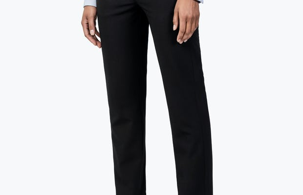 Women's Black Velocity Dress Pant on Model Facing to Her Right