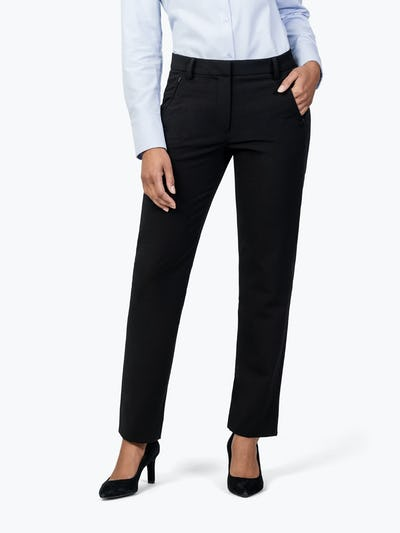 Women's Black Velocity Dress Pant on Model with Left Hand in Her Pocket