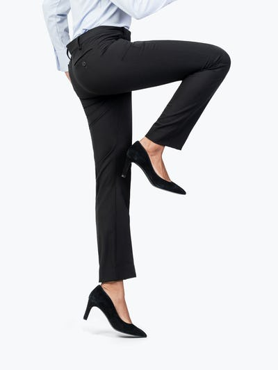 Women's Black Velocity Dress Pant on Model Raising Her Right Leg