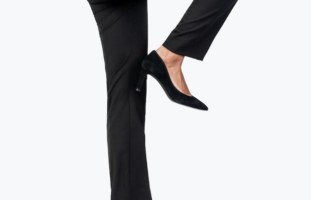 Women's Black Velocity Dress Pant on Model Raising Her Right Leg