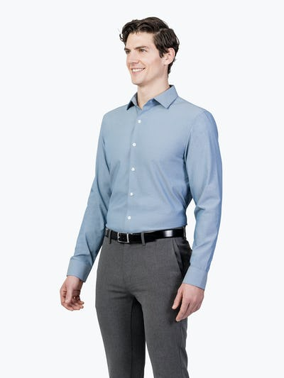 Men's Blue Oxford Aero Zero Dress shirt model facing forward and to the right