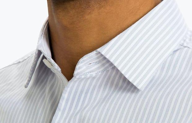 Men's Cool Grey Dot Stripe Aero Dress Shirt on Model Facing Forward in Close-Up of Unbuttoned Collar