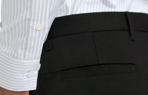 Men's Cool Grey Dot Stripe Aero Dress Shirt on Model Facing Backward in Close-Up of Sleeve Cuff and Buttons