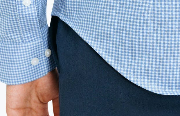 Men's Light Blue Gingham Hybrid Button Down on Model in Close-Up of Bottom Hem Line and Sleeve Cuff