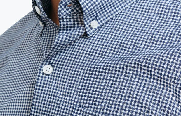 Men's Navy Gingham Hybrid Button Down on Model Facing Right in Close-Up of Button-Down Collar