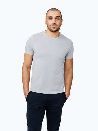 Men's Stone Previous Generation Composite Merino Tee  on Model Facing Forward with Hands in Pockets