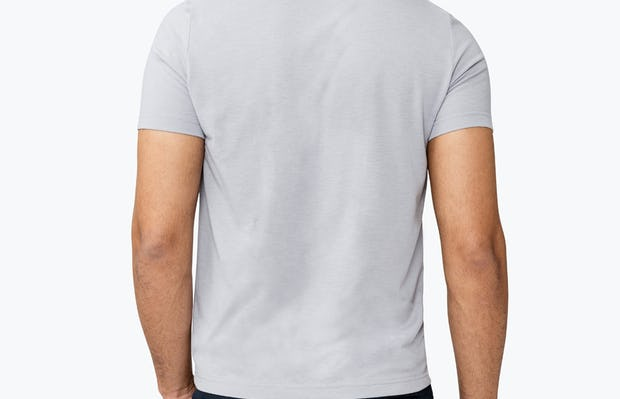 Men's Stone Previous Generation Composite Merino Tee  on Model Facing Backward with Hand in Pocket