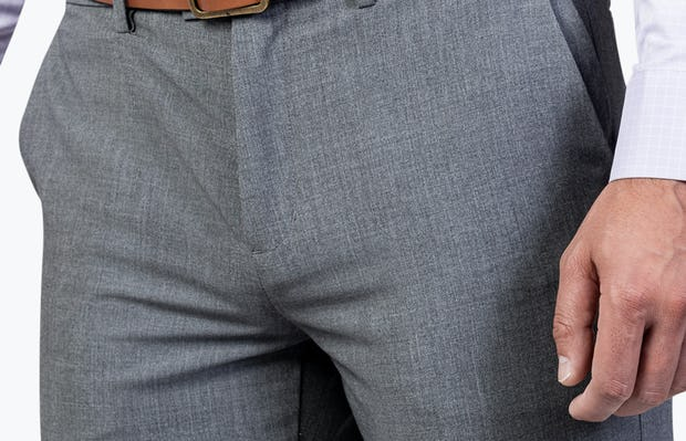 Men's Graphite Velocity Dress Pant on Model in Close-Up of Front Pocket and Closure