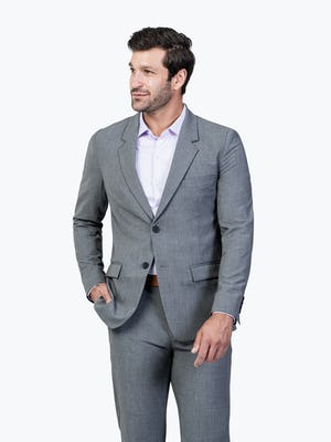 Men's Graphite Velocity Suit Jacket on Model Walking Forward with Hand in Pant Pocket
