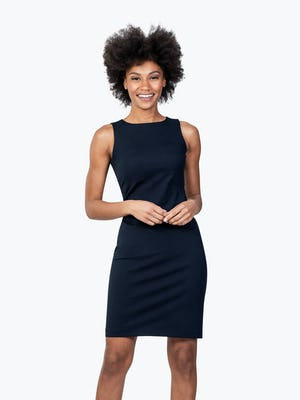 Women's Navy Kinetic Sheath Dress on Model with Hands in Front of Her