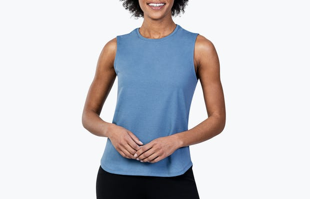 Women's Storm Blue (Recycled) Composite Merino Tank on Model with Hands in Front of Her