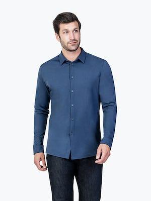 Men's Cadet Blue Composite Merino shirt model facing forward looking left