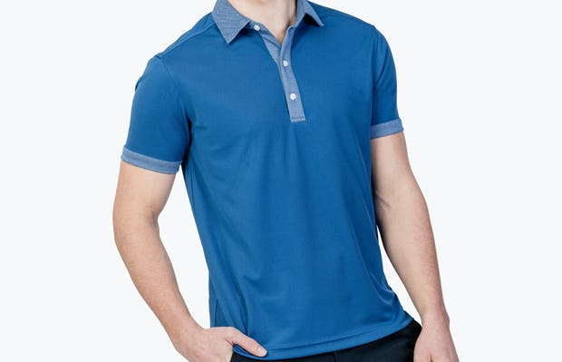Apollo Polo Royal Blue Tipped on Model Facing Forward with hand in pocket