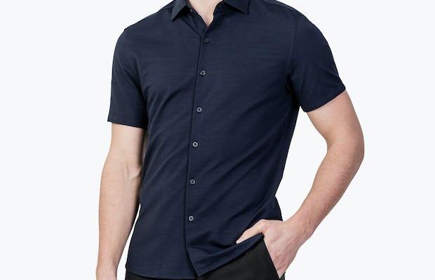Men's Navy Hybrid Seersucker Slim Short Sleeve on Model Facing Forward with Hand in Pant Pocket