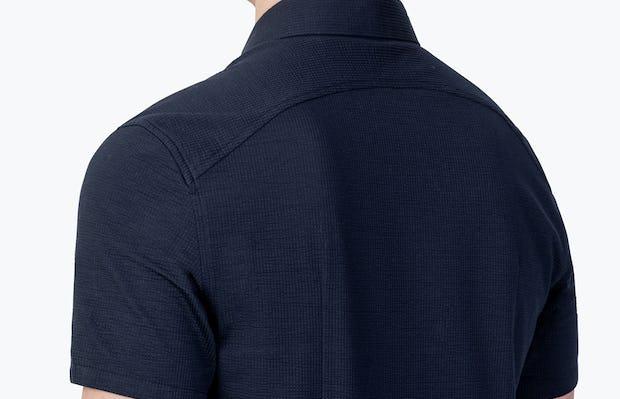 Men's Deep Navy Hybrid Seersucker Slim Short Sleeve on Model Facing Backward in Close-Up of Curved Back Yoke