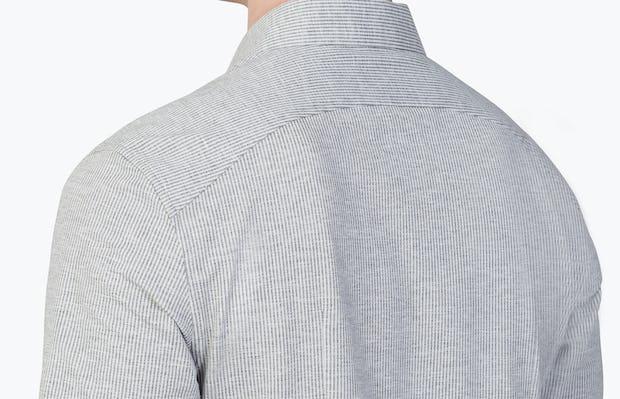Men's Grey Stripe Hybrid Seersucker Slim Short Sleeve on Model Facing Backward in Close-Up of Curved Back Yoke