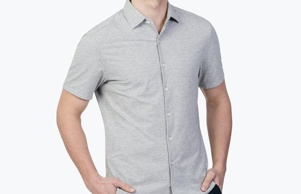 Men's Grey Stripe Hybrid Seersucker Slim Short Sleeve on Model Facing Forward with Hands in Pants Pockets