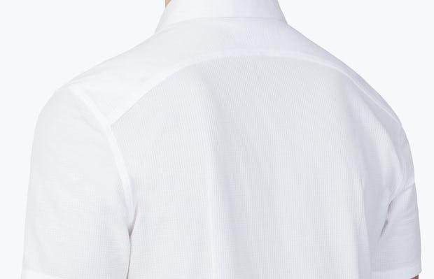 Men's White Hybrid Seersucker Slim Short Sleeve on Model Facing Backward in Close-Up of Curbed Back Yoke