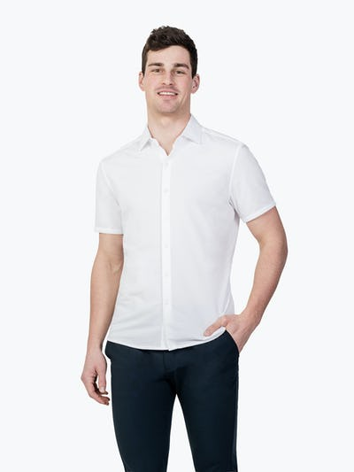 Men's White Hybrid Seersucker Slim Short Sleeve on Model Facing Forward with Hand in Pant Pocket