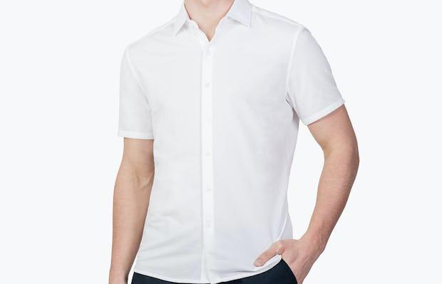 Men's White Hybrid Seersucker Slim Short Sleeve on Model Facing Forward with Hand in Pant Pocket