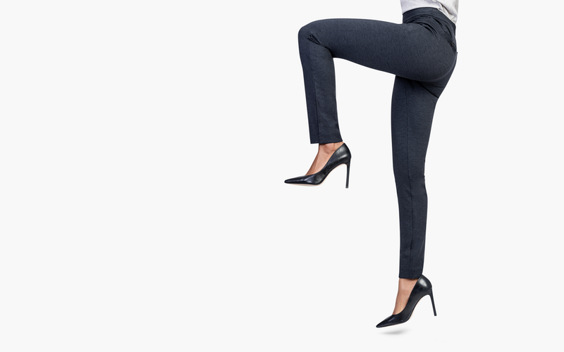 Women lifts knee to show how the pants can stretch