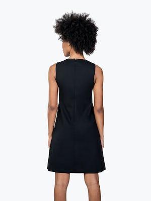Women's Black Kinetic A-Line Dress on Model Facing Backward