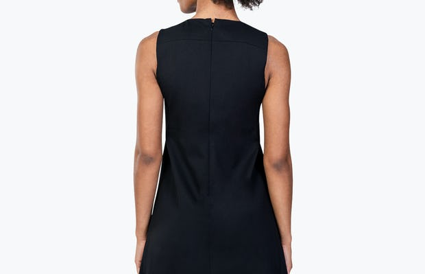 Women's Black Kinetic A-Line Dress on Model Facing Backward