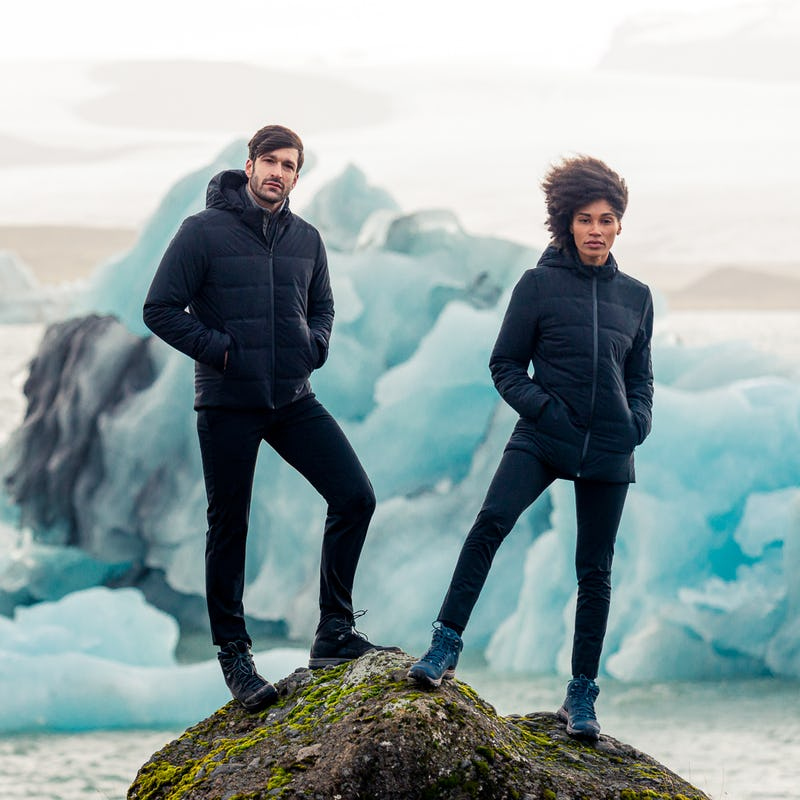 People standing in front of an iceberg, wearing Mercury Jackets