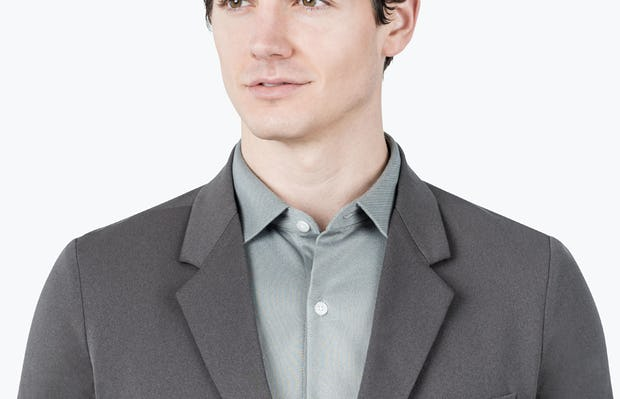 Men's Charcoal Heather Kinetic Blazer - close shot of model facing forward