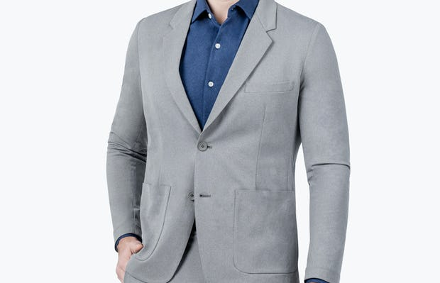 Men's Grey Heather Kinetic Blazer -model facing forward with hand in pocket