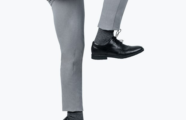 Men's Grey Kinetic Pants on model jumping with right knee raised