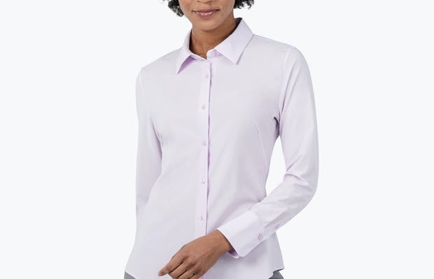 Women's Pale Pink Juno Recycled Tailored Shirt on Model with One Hand Behind Her Back