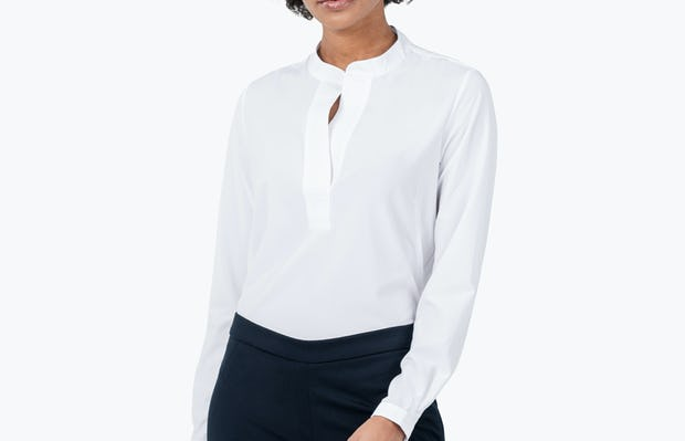 Women's White Juno Popover on Model with Her Head Tilted
