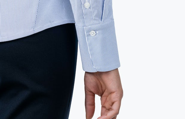 Women's Blue Stripe Aero Dress Shirt on Model in Close-up of Her Shirt Cuff