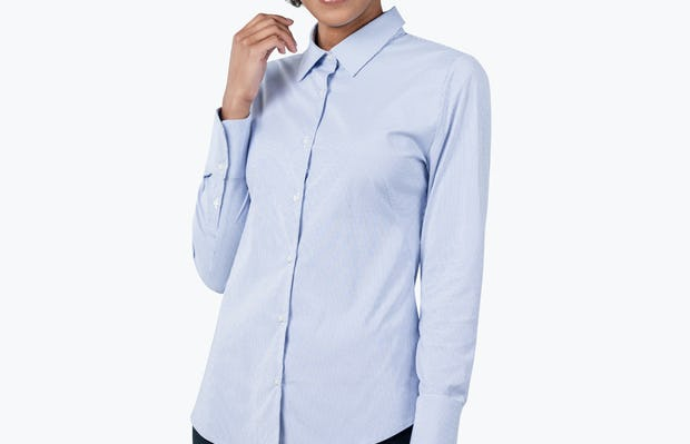 Women's Blue Stripe Aero Dress Shirt on Model Smiling with Right Arm Raised