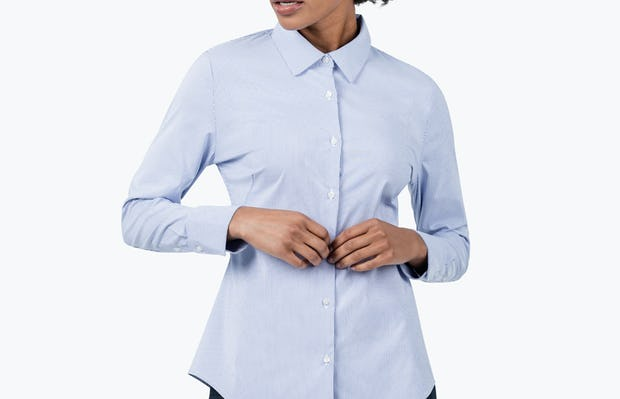 Women's Blue Stripe Aero Dress Shirt on Model with Arms in Front of Her