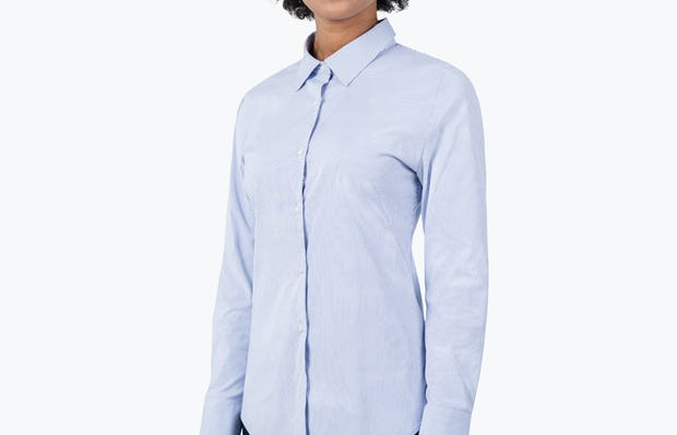 Women's Blue Stripe Aero Dress Shirt on Model with Arms by Her Side